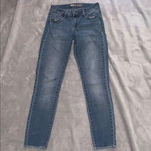 Light wash, mid rise denim jeans